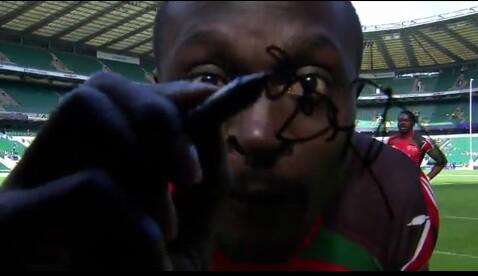 Collins injera penning his signnature on the camera