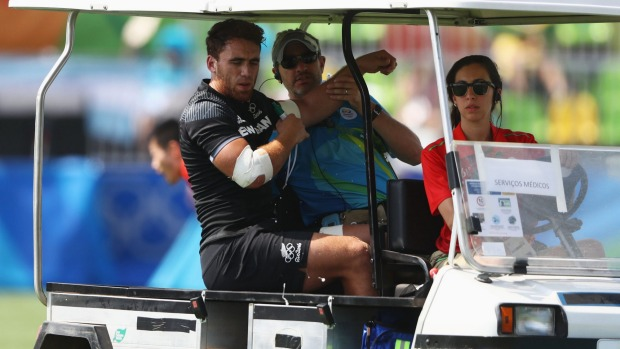 Photo : David Rodgers / Joe Webber driven off the pitch in a medi-cab.